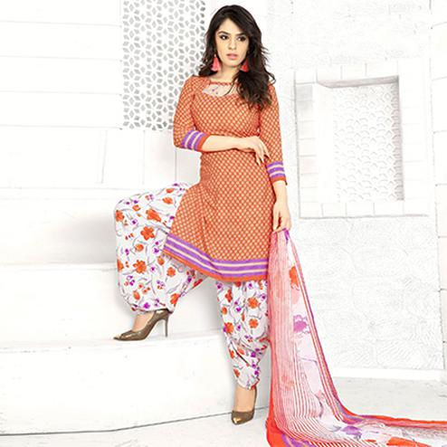 Flamboyant Orange Colored Casual Wear Printed Crape Semi Patiyala Dress Material