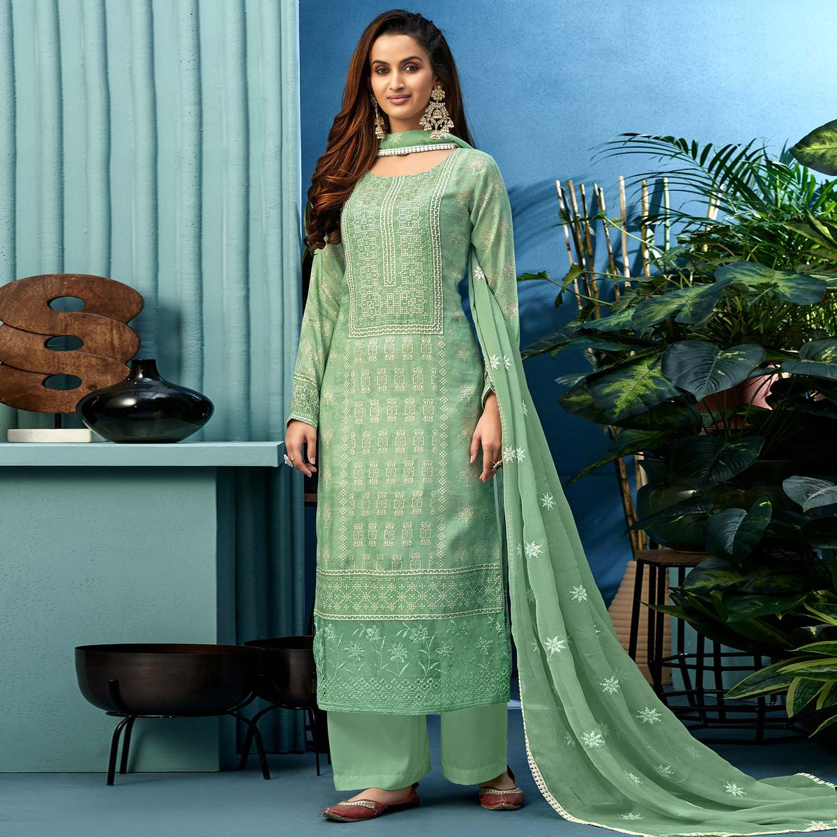 Glorious Green Colored Partywear Digital Printed Pure Muslin Palazzo Suit