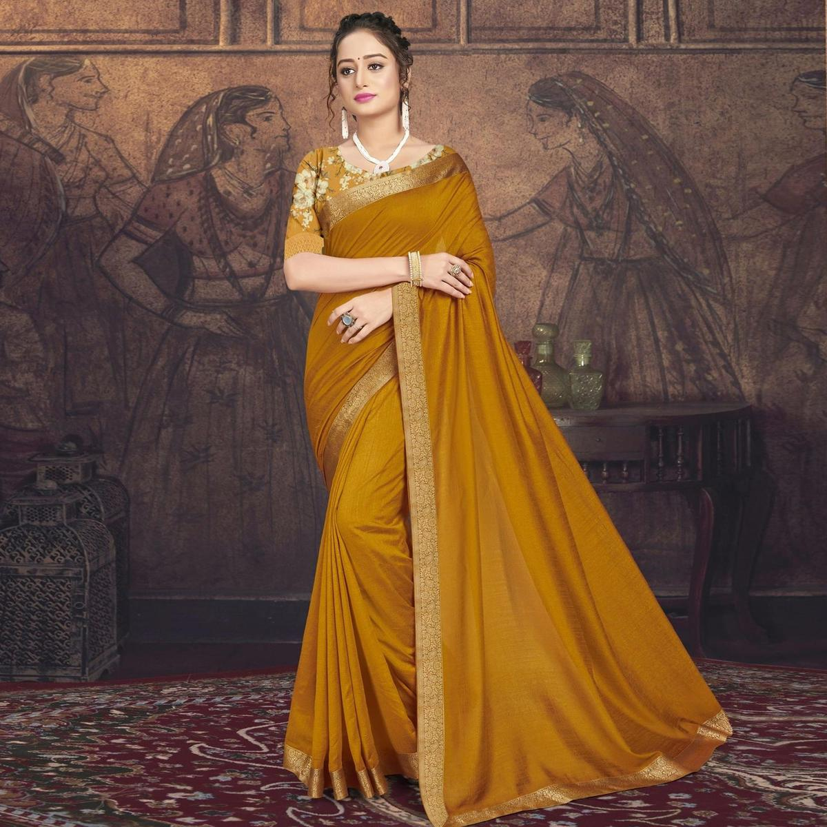 Triveni Gold Metallic Colored Chanderi Silk Casual Wear Solid Saree With Blouse Piece