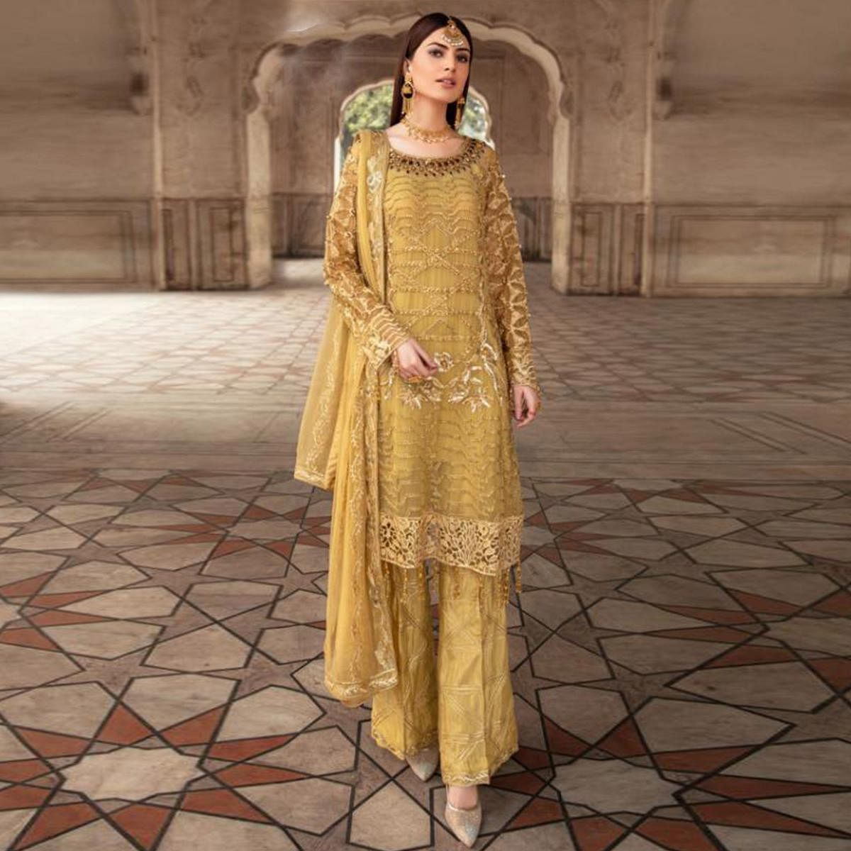 Lovely yellow Coloured Embroidered With Stone Work Partywear Fox Georgette Suit