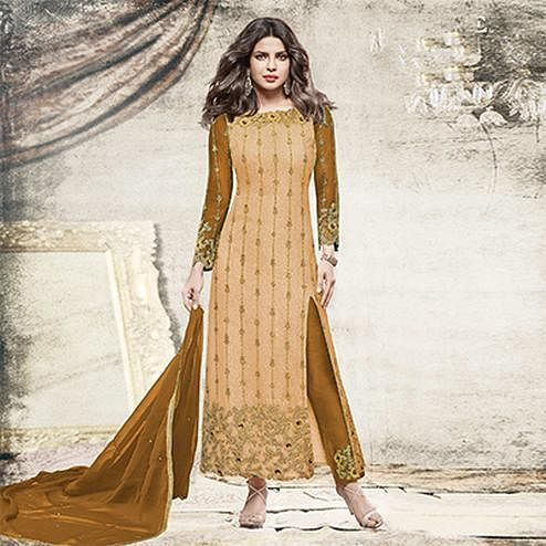 Stunning Light orange Partywear Designer Embroidered Net Suit