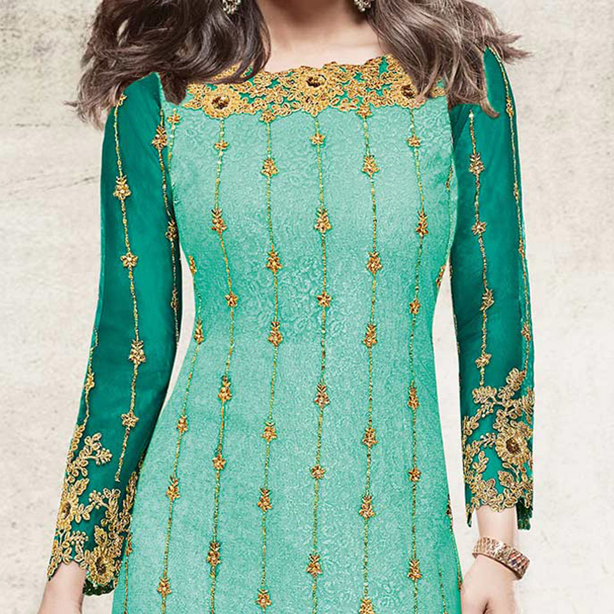 Adorable Teal Blue Partywear Designer Embroidered Net Suit