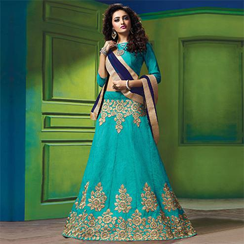 Graceful Blue Colored Designer Embroidered Raw Silk Lehenga Choli