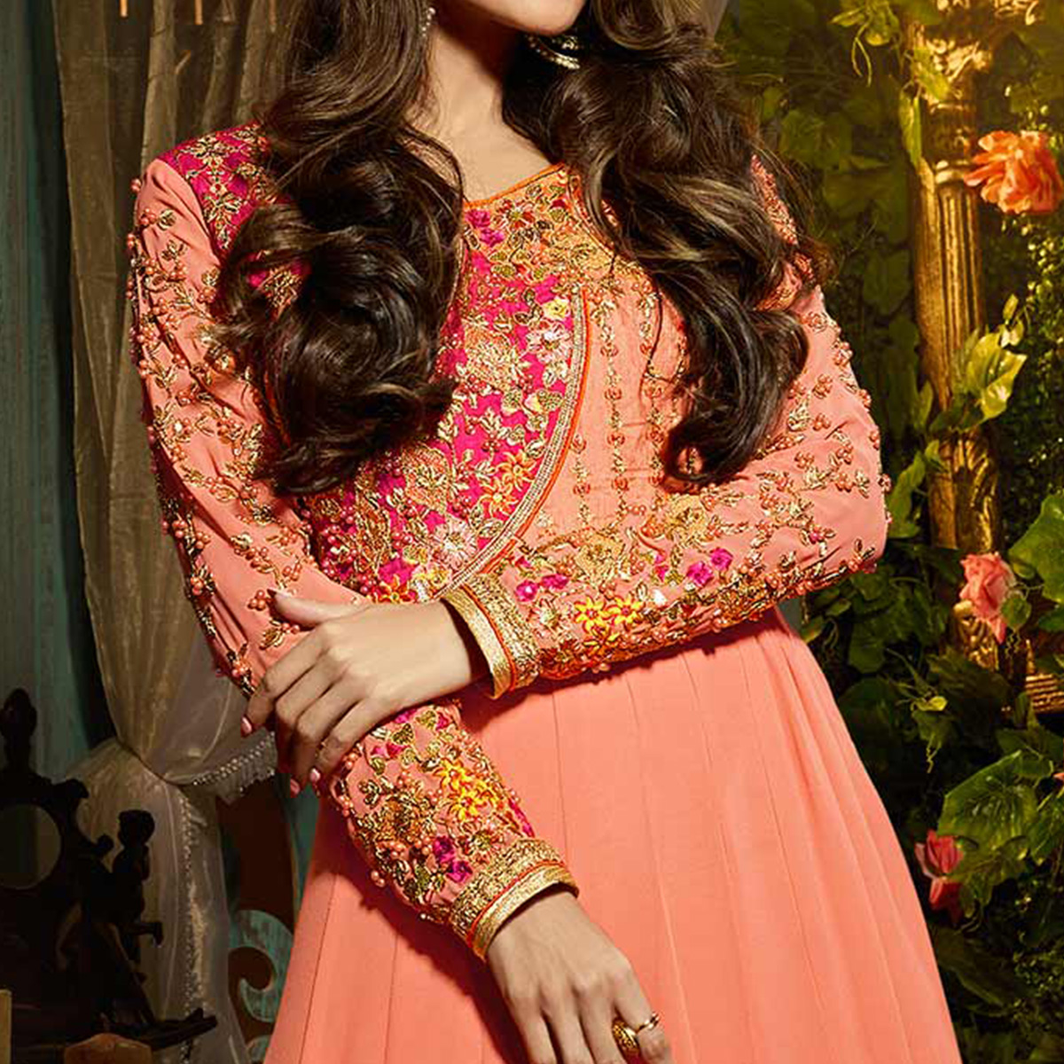 Eye-Catching Peach Colored Designer Embroidered Partywear Georgette Anarkali Suit