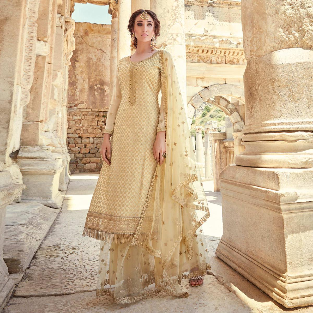 Intricate Cream Coloured Designer Partywear Embroidered Heavy Faux Georgette Palazzo Suit