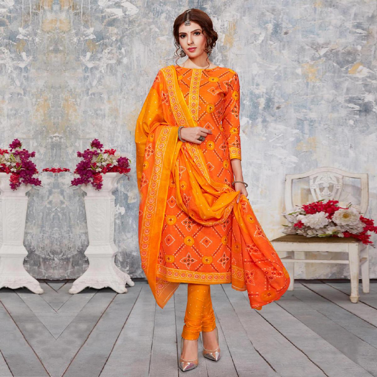 Sophisticated Orange Colored Casual Wear Bandhani Printed Pure Cotton Dress Material