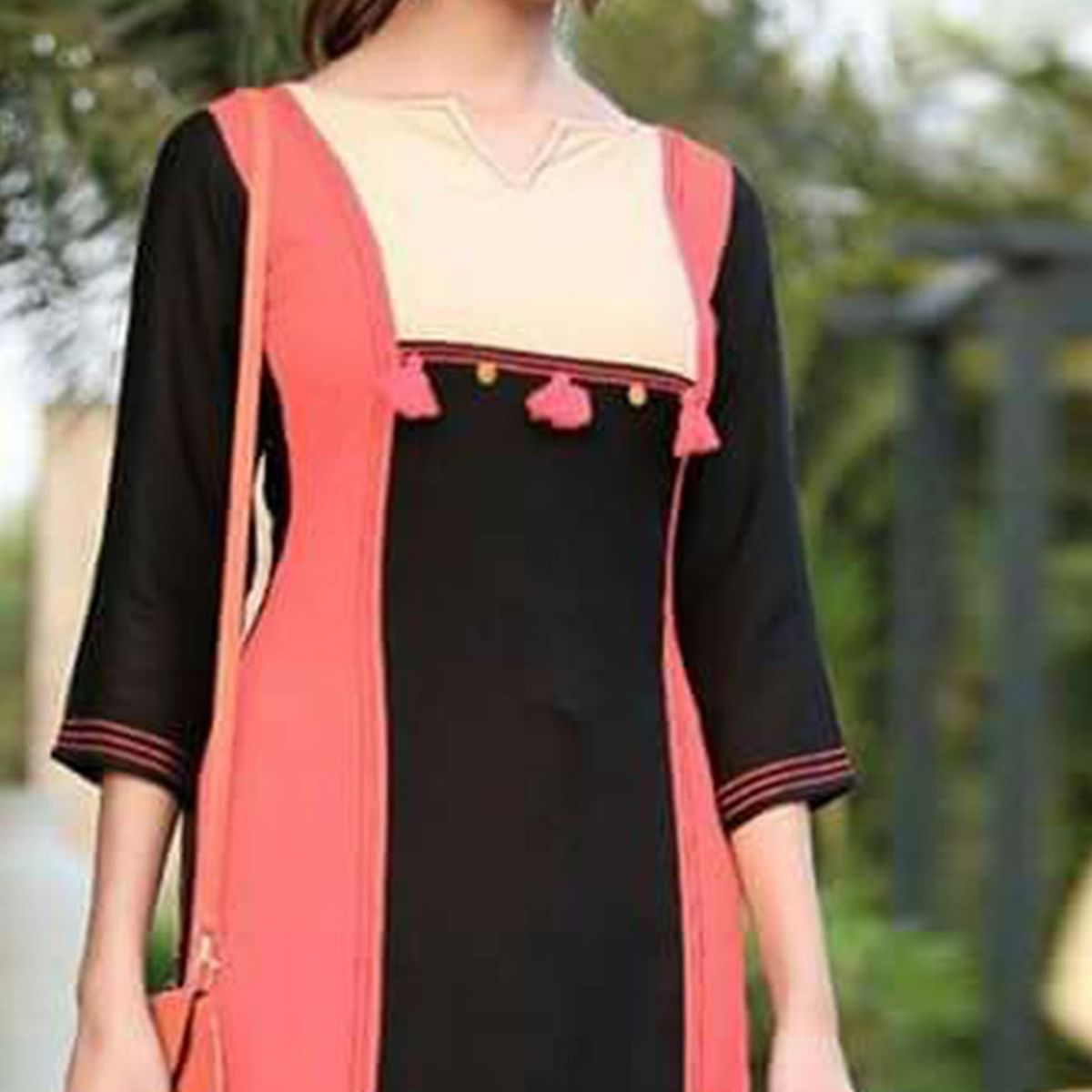 Eye-Catching Black-Peach Colored fancy Rayon Kurti