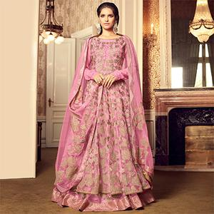 Attractive Pink Colored Designer Embroidered Partywear Netted Lehenga Kameez