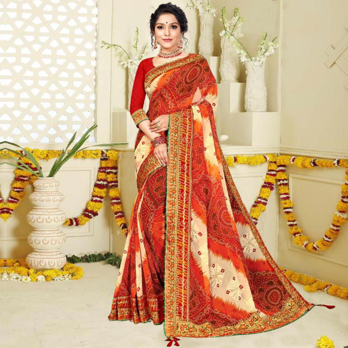 Innovative Red and White Colored Festive Wear Bandhani Print With Zari Border Work And Latkan Heavy Georgette Saree