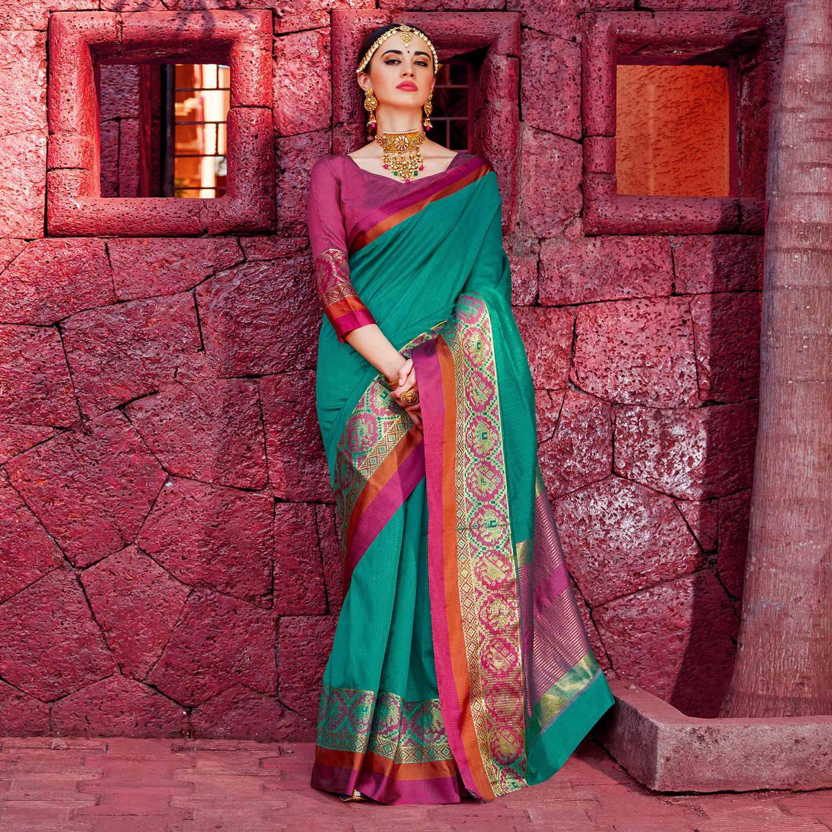 Flaunt Teal Colored Festive Wear Silk Woven Saree