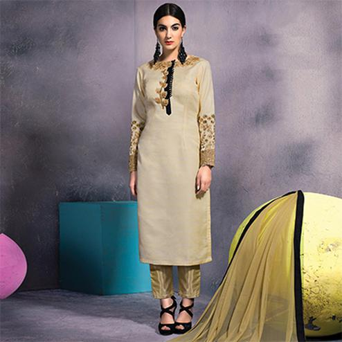 Stunning Beige Colored Partywear Embroidered Designer Art Silk Suit