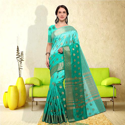 Beautiful Turquoise Green Colored Festive Wear Raw Silk Saree