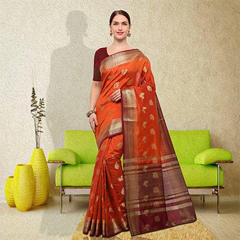 Traditional Orange Colored Festive Wear Raw Silk Saree