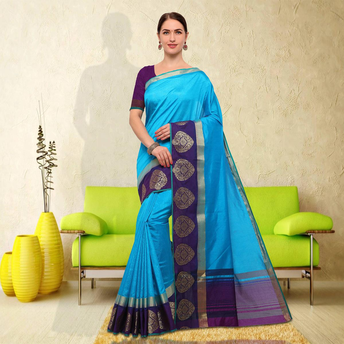 Delightful Sky Blue Colored Festive Wear Raw Silk Saree