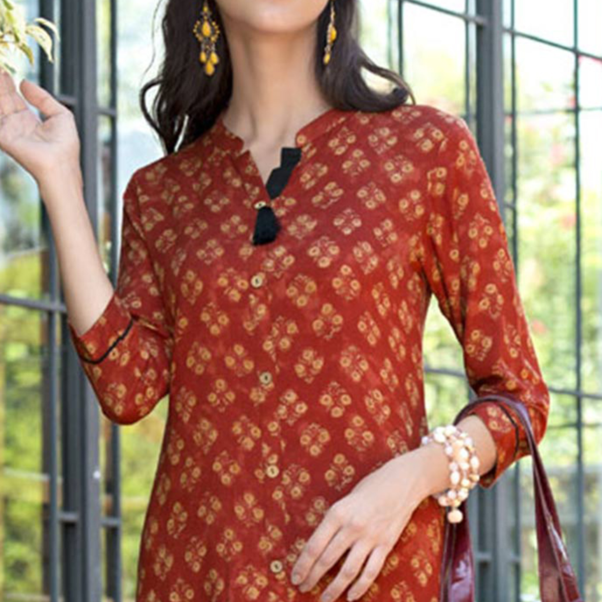 Dazzling Rust Colored Casual Printed Rayon Kurti