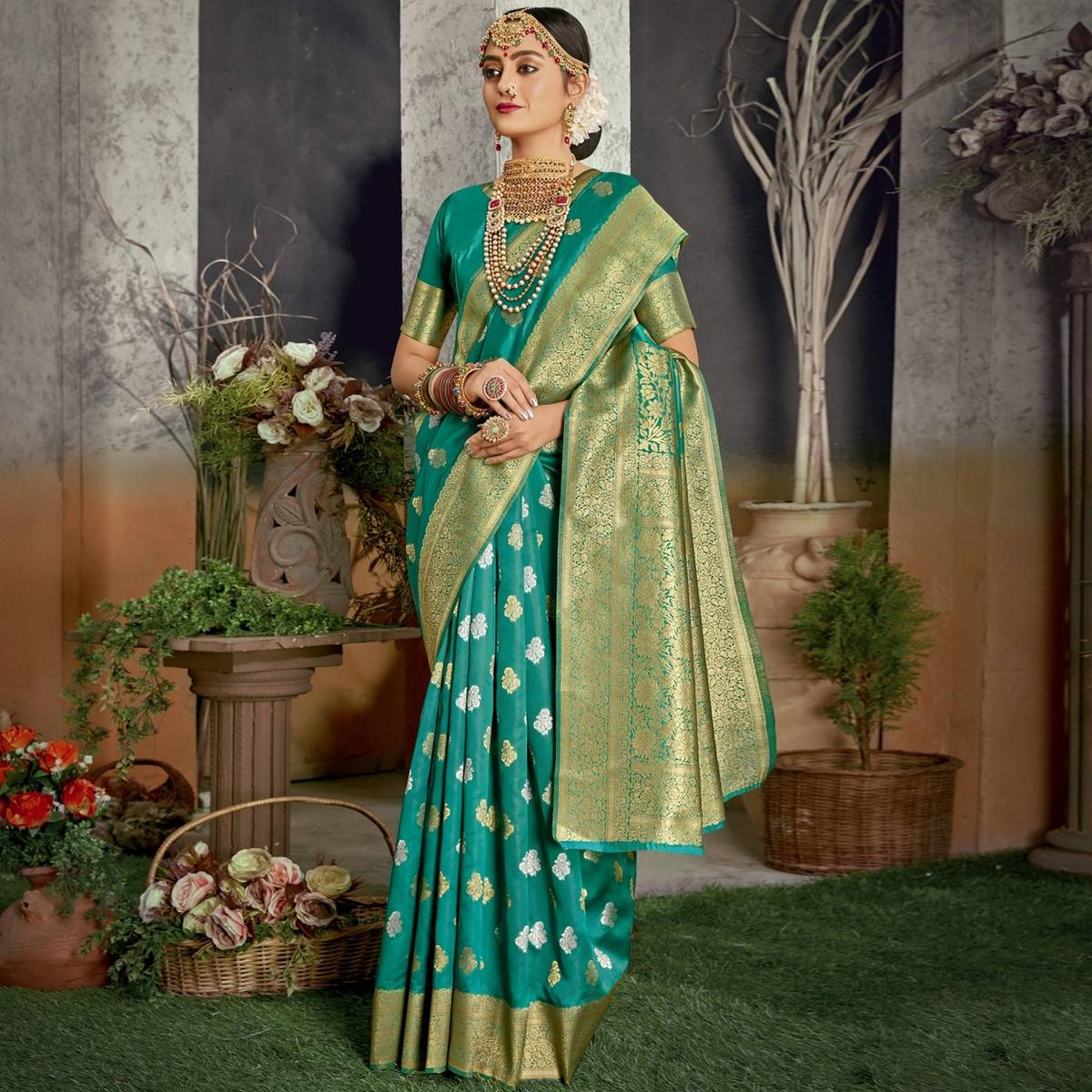 Triveni Turquoise Colored Jacquard Silk Party Wear Jacquard Woven Saree With Blouse Piece