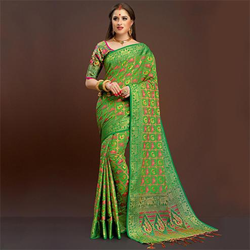 Rich Green Colored Festive Wear Silk Woven Saree