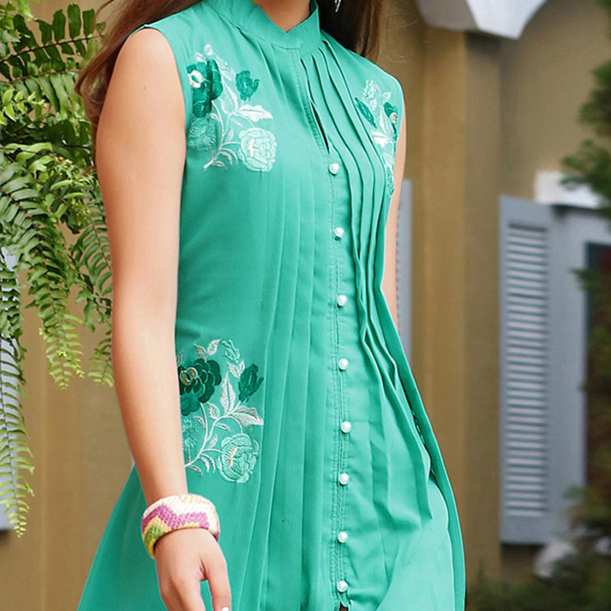 Alluring Teal Fancy Embroidered Georgette Kurti