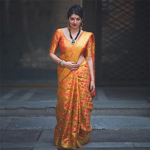 Arresting Yellow Colored Festive Wear Designer Woven Patola Silk Saree