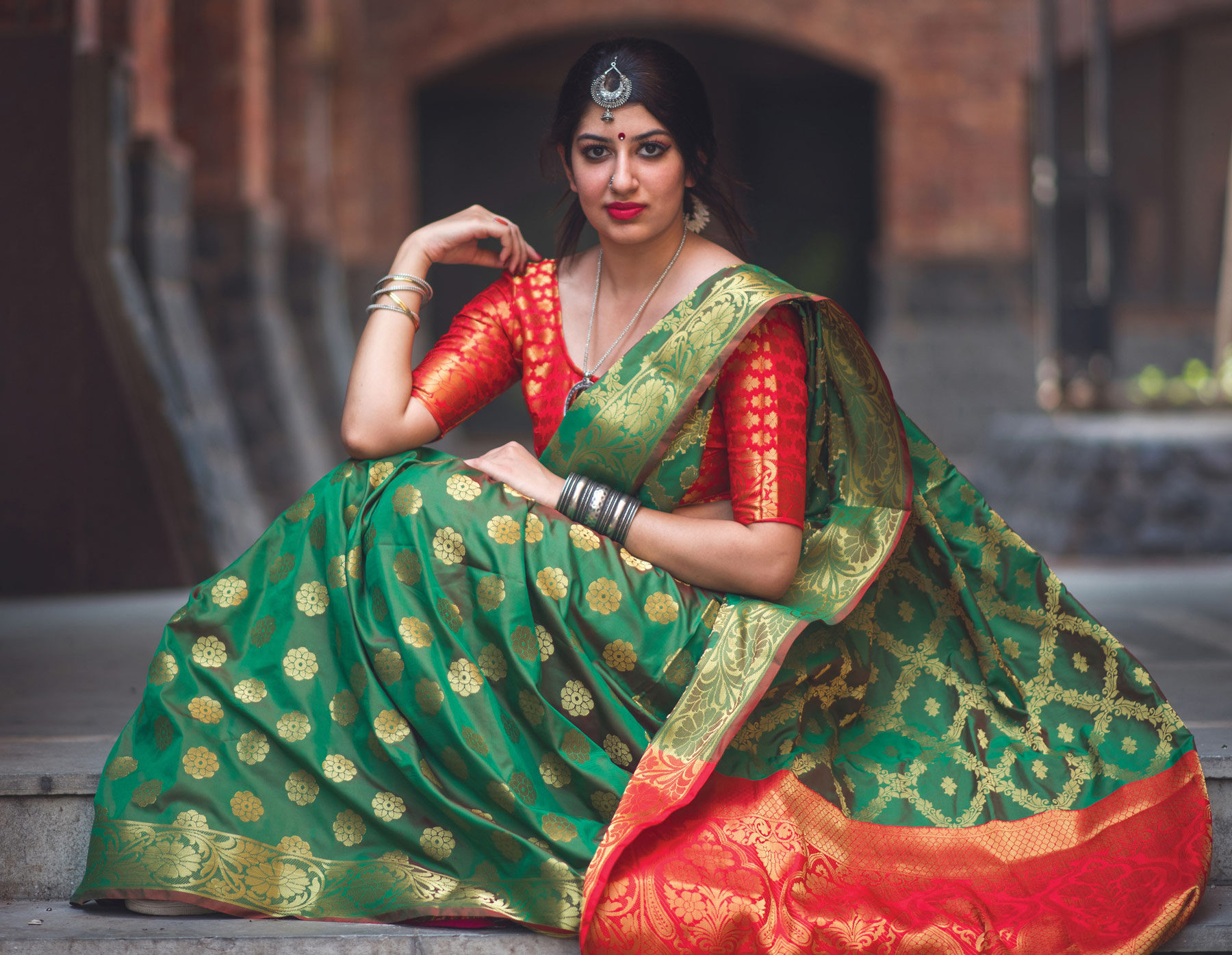 Graceful Green Colored Festive Wear Designer Woven Patola Silk Saree
