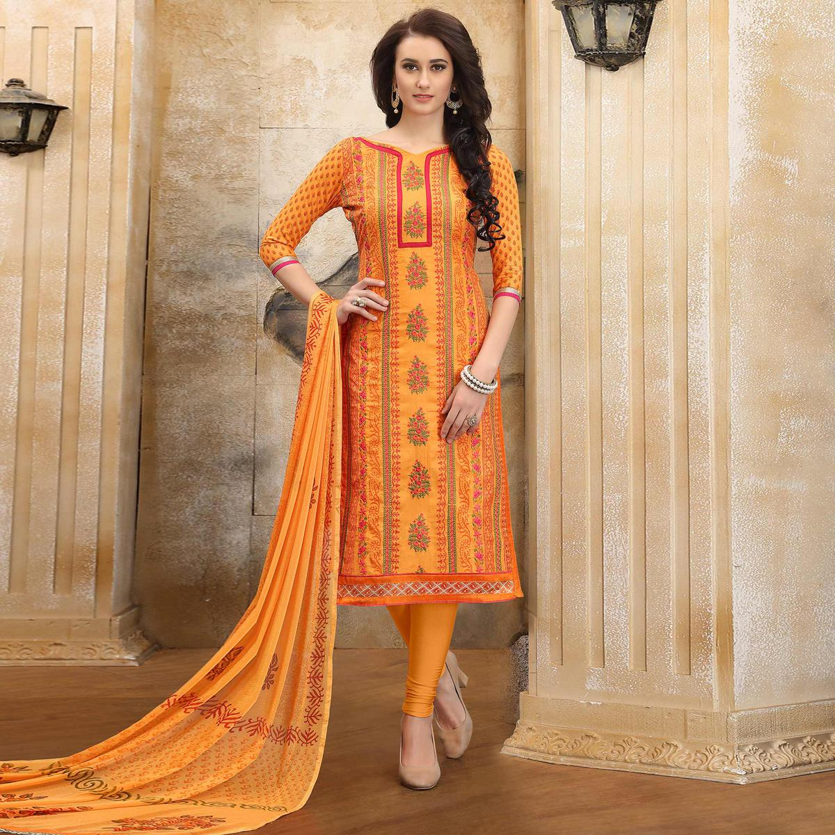 Graceful Orange Colored Thread Embroidered Cotton Dress Material