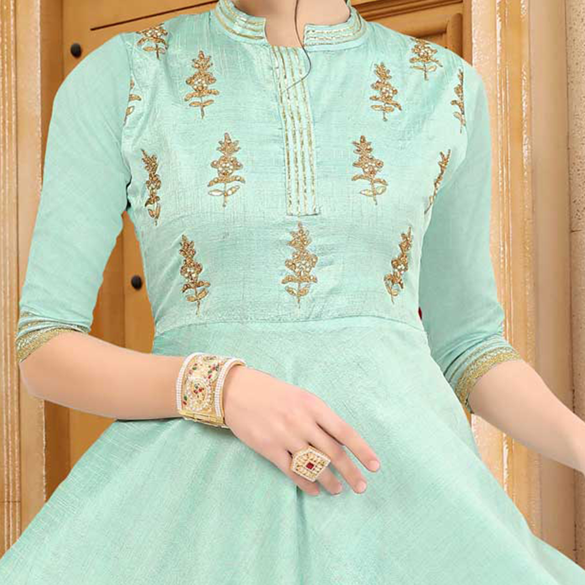 Adorning Aqua Green Colored Embroidered Partywear Art Silk Kurti