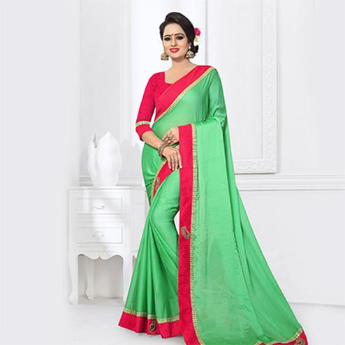 Dazzling Green Colored Partywear Satin Silk Saree