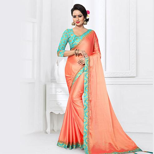 Fabulous Peach Colored Partywear Satin Silk Saree