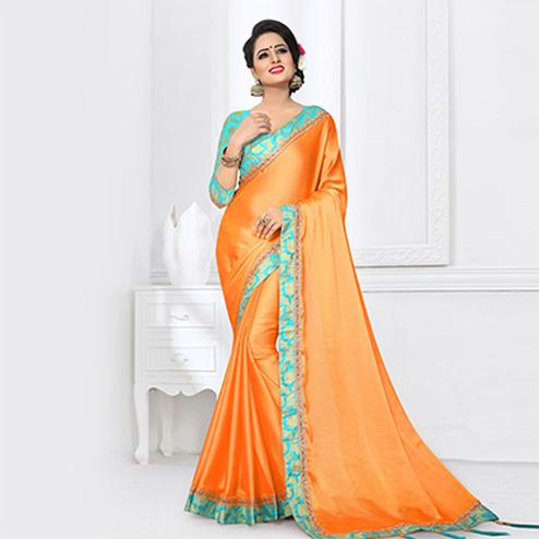 Appealing Orange Colored Partywear Satin Silk Saree