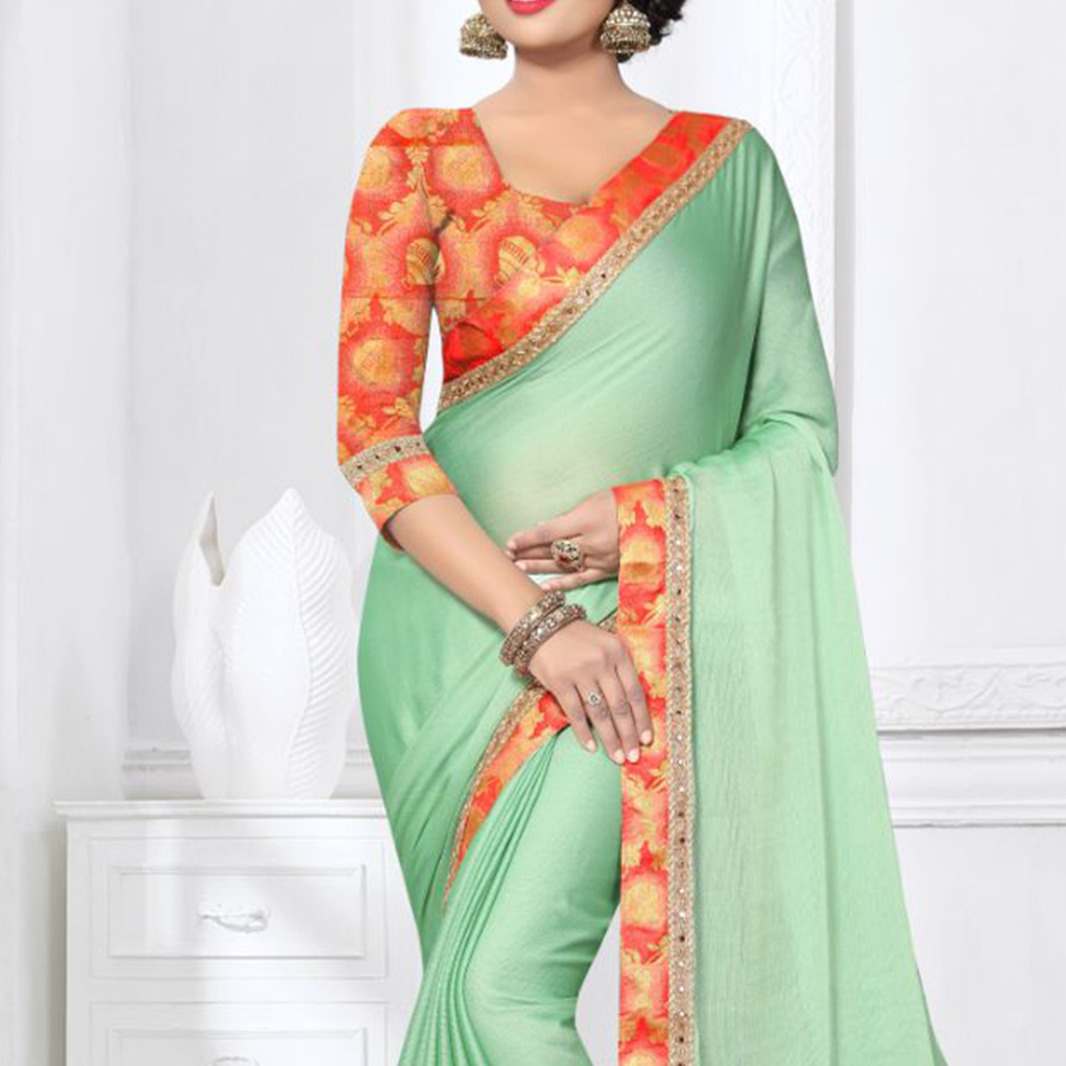 Charming Pista Green Colored Partywear Satin Silk Saree