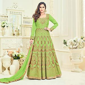 Dazzling Green Colored Heavy Embroidered Partywear Banglori Silk Anarkali Suit