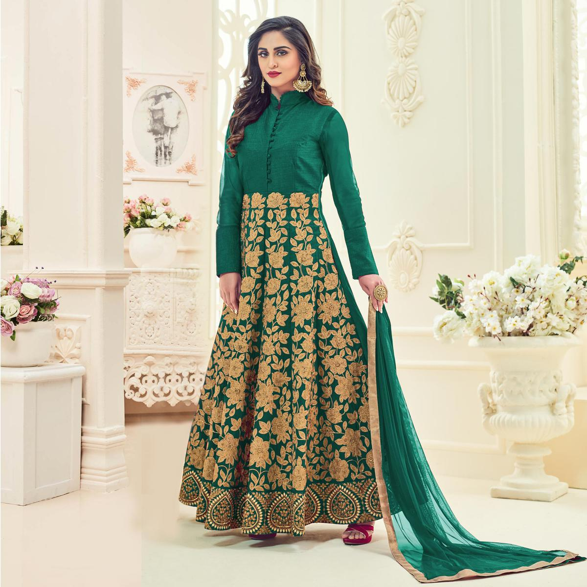 Trendy Turquoise Colored Heavy Embroidered Party Wear Raw Silk Anarkali Suit