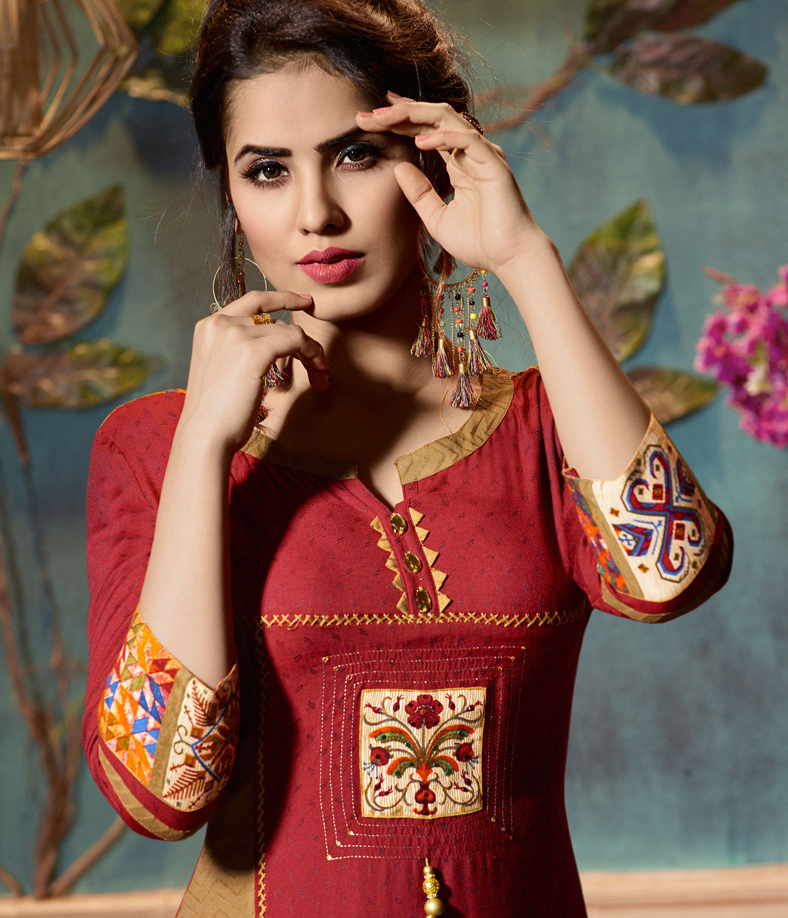 Elegant Red Colored Fancy Embroidered Rayon Kurti
