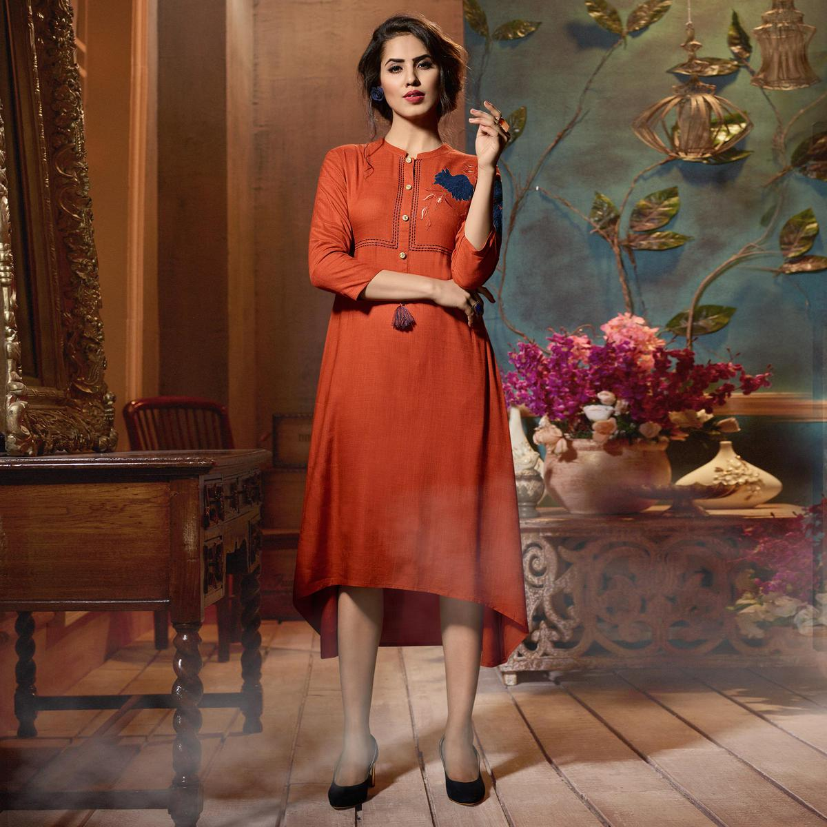 Unique Rust Orange Colored Fancy Embroidered Rayon Kurti