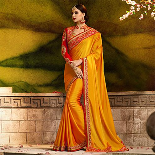 Prominent Orange Colored Partywear Embroidered Rangoli Silk Saree