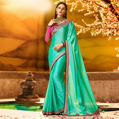 Glowing Sea Green Colored Partywear Embroidered Rangoli Silk Saree
