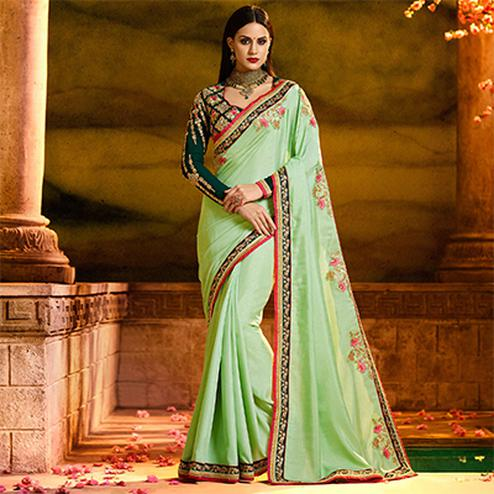 Snazzy Pista Green Colored Partywear Embroidered Magic Silk Saree