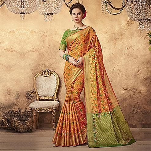 Eye-catching Orange Colored Festive Wear Patola Silk Saree