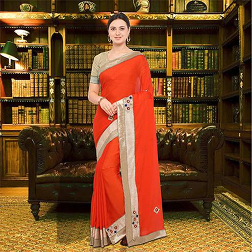 Stunning Orange Colored Party Wear Georgette Saree