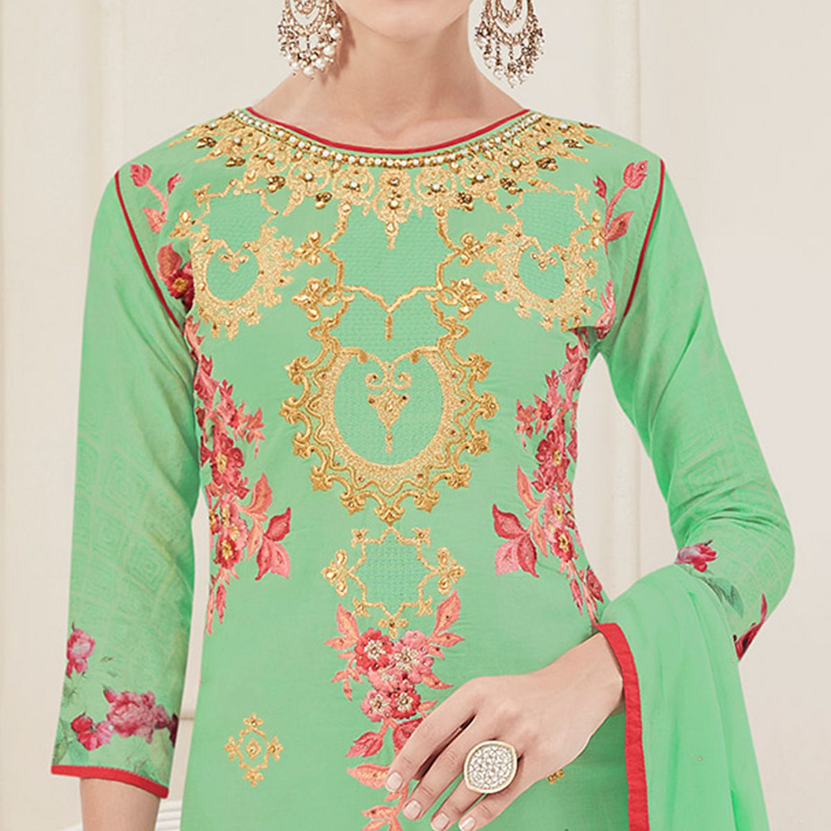 Pleasant Pista Green Colored Partywear Embroidered Pure Cotton Suit