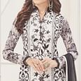 Snazzy Off-White Colored Partywear Embroidered Pure Cotton Suit
