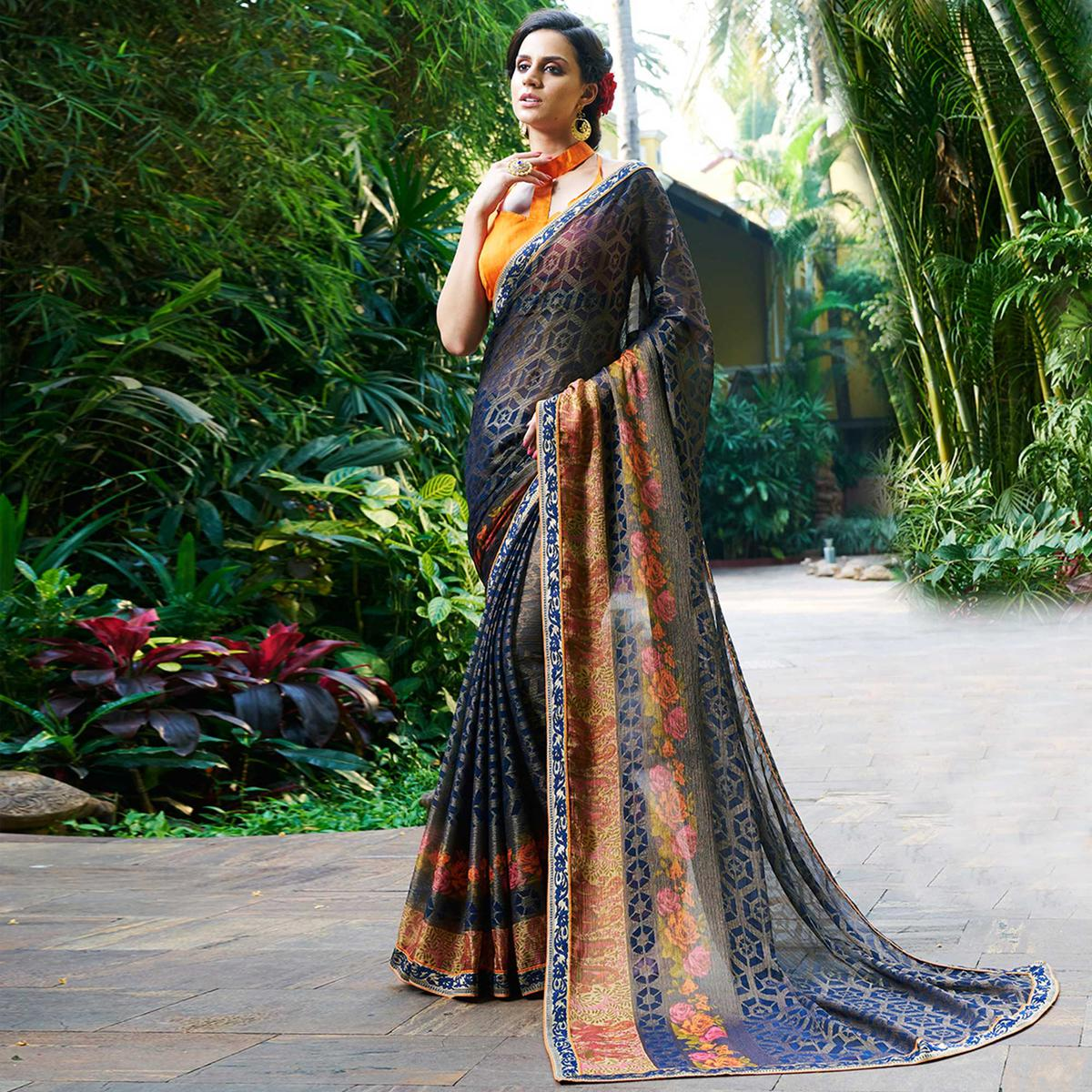 Unique Blue Colored Casual Printed Chiffon Brasso Saree