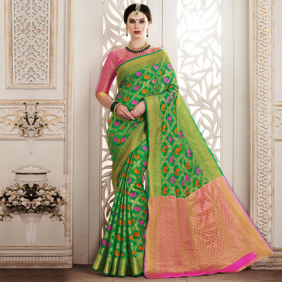 Charming Green Colored Festive Wear Patola Silk Saree