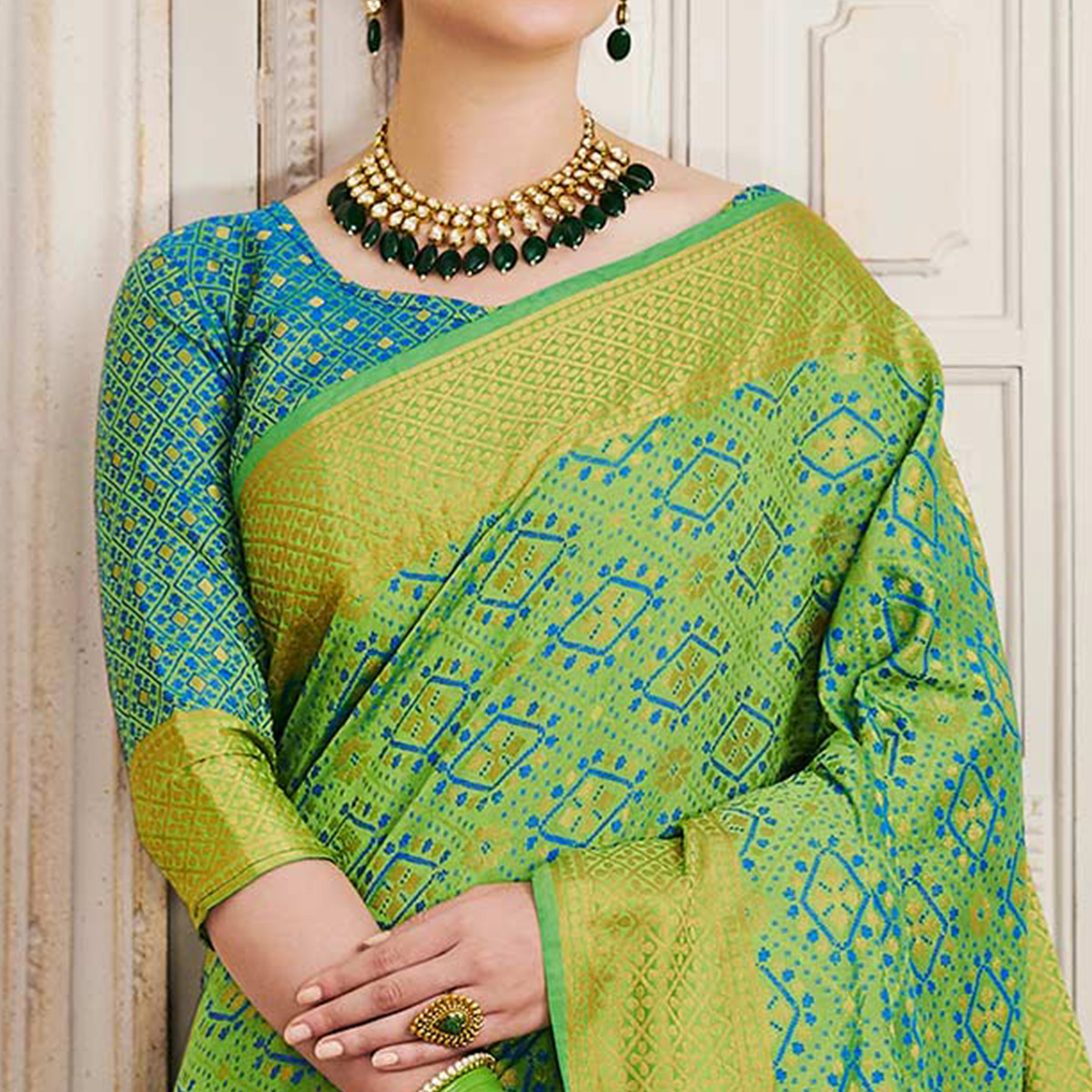 Blooming Pista green Colored Festive Wear Patola Silk Saree