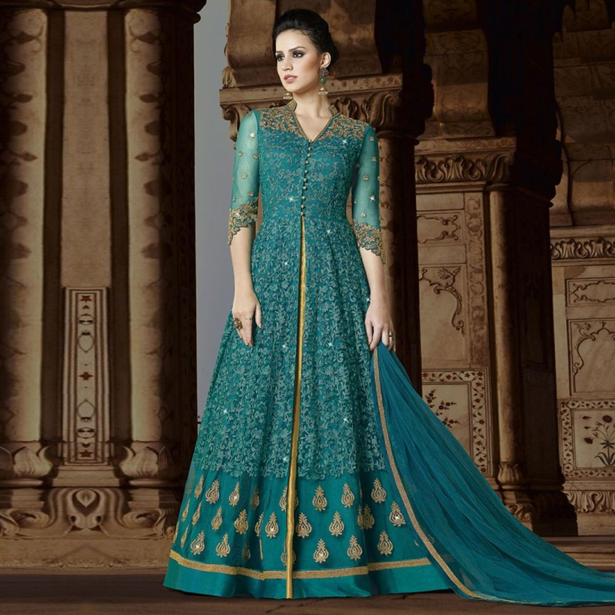 Stunning Turquoise Green Colored Embroidered Partywear Abaya Style Netted Lehenga / Anarkali Suit