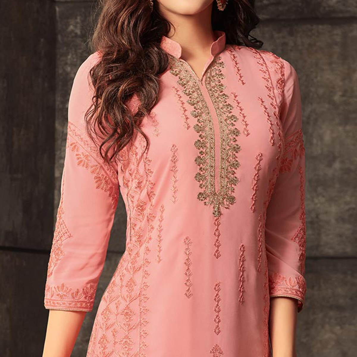 Lovely Peach Colored Designer Embroidered Georgette Suit