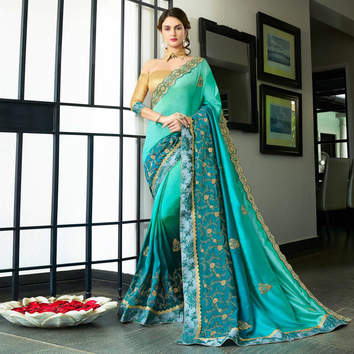 Unique Turquoise Blue Colored Partywear Embroidered Chiffon Saree