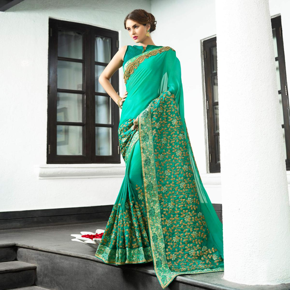 Dazzling Teal Green Colored Partywear Embroidered Satin Silk Saree