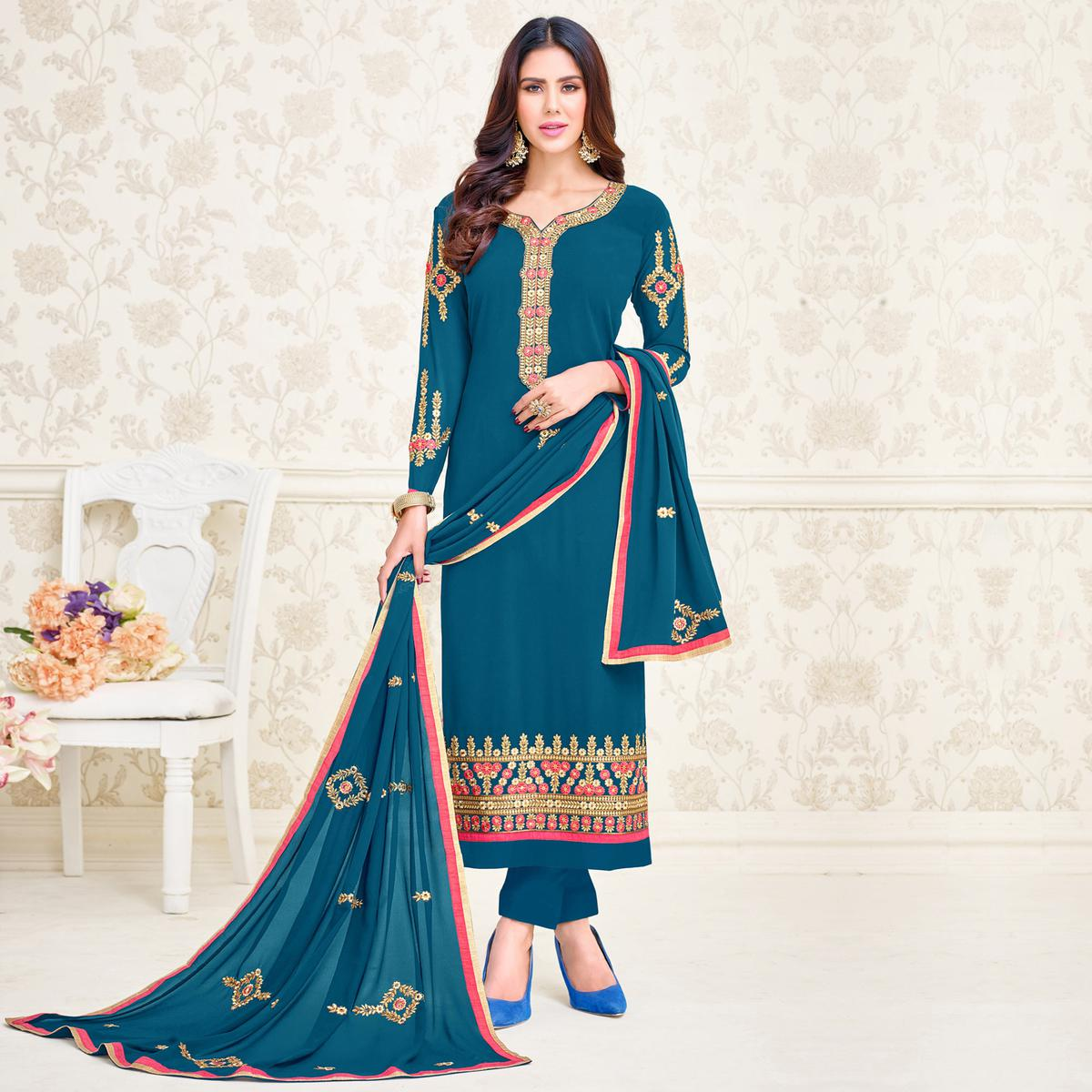 Unique Teal Blue Colored Partywear Embroidered Georgette Suit