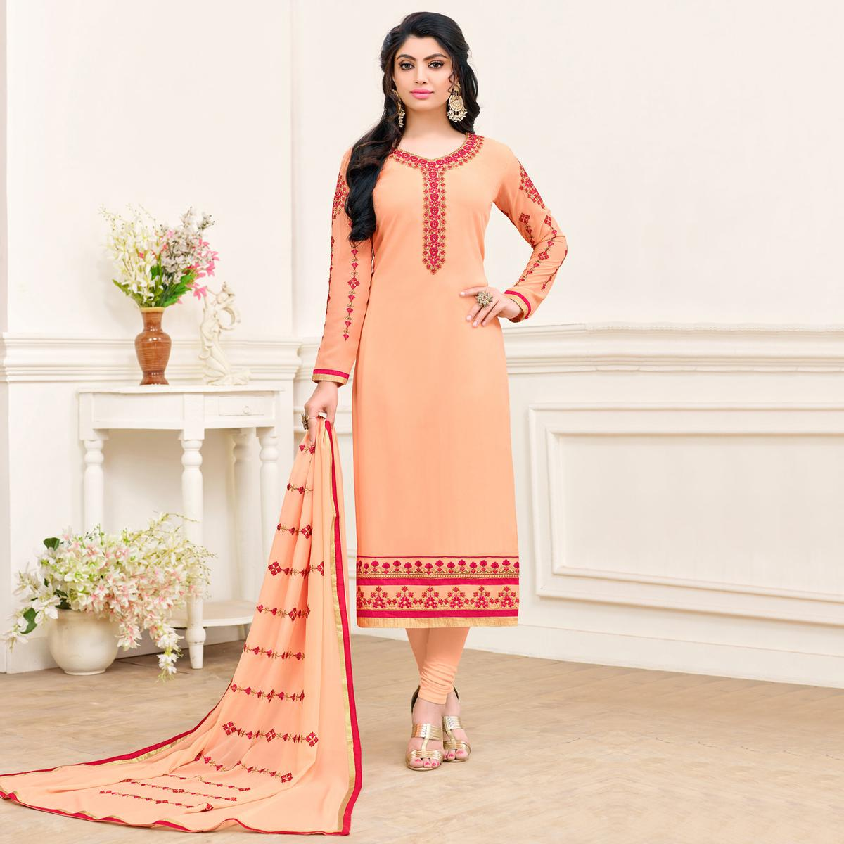 Eye-Catching Light Orange Colored Partywear Embroidered Georgette Suit